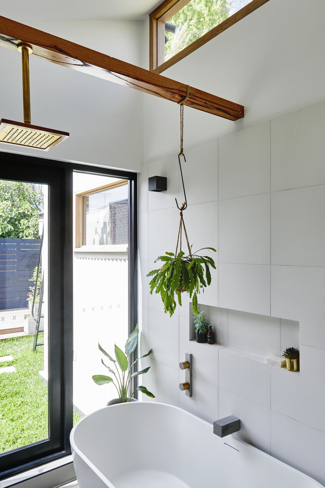 Bath Room, Open Shower, and Freestanding Tub Wood Melbourne supplied the Otis timber and brass shower head.    Photo 11 of 13 in An Old Worker's Cottage Is Reborn Into an Eco-Friendly Home and Learning Center