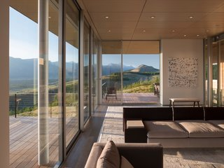 Full-height glazing wraps around the living spaces, which overlook the expansive Wyoming landscape.