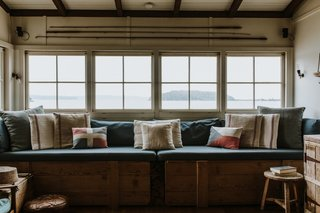 A full-length window seat overlooks views of the beach and bay.