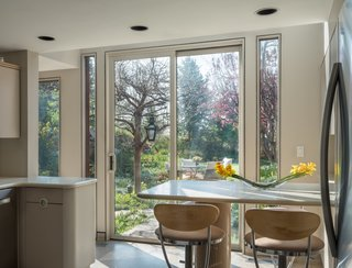 A breakfast nook in the kitchen faces a serene garden.
