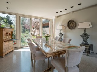 Sliding glass doors fill the dining room with abundant natural light.