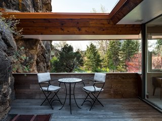The deck has been recently rebuilt with silver mahogany and is situated for views of Red Rocks and the Flatirons.