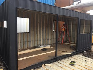 """Contanium is based in Red Hook, Brooklyn, so I could ride my bike down to the yard and meet with Mike O'Toole (owner/engineer) to talk about the design and watch the build progress,"" explains Porter of the process. ""Within the first few days of the build, I couldn't recognize the container. It magically transformed into a small cabin."""