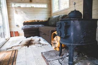 The Swedish wood-burning stove can keep the cabin toasty warm all night long.
