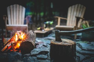 Adirondack chairs set the scene at the outdoor campfire site. Fatwood firestarter is also provided with your stay.
