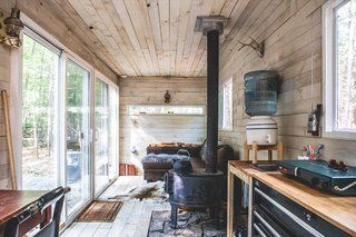 The couple laid oak planks atop the container's marine plywood floor—sealed with penetrating epoxy—and finished the oak in a gray wash and water-soluble urethane. The whitewashed pine walls were also treated with the same sealant.