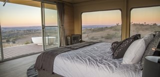 Guests wake up to views overlooking undulating hills and ridges.