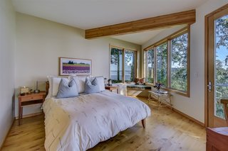 A built-in window seat in the corner of the master bedroom overlooks views in two directions.