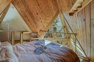 The loft, accessible via ladder in the kitchen, houses a second bedroom.