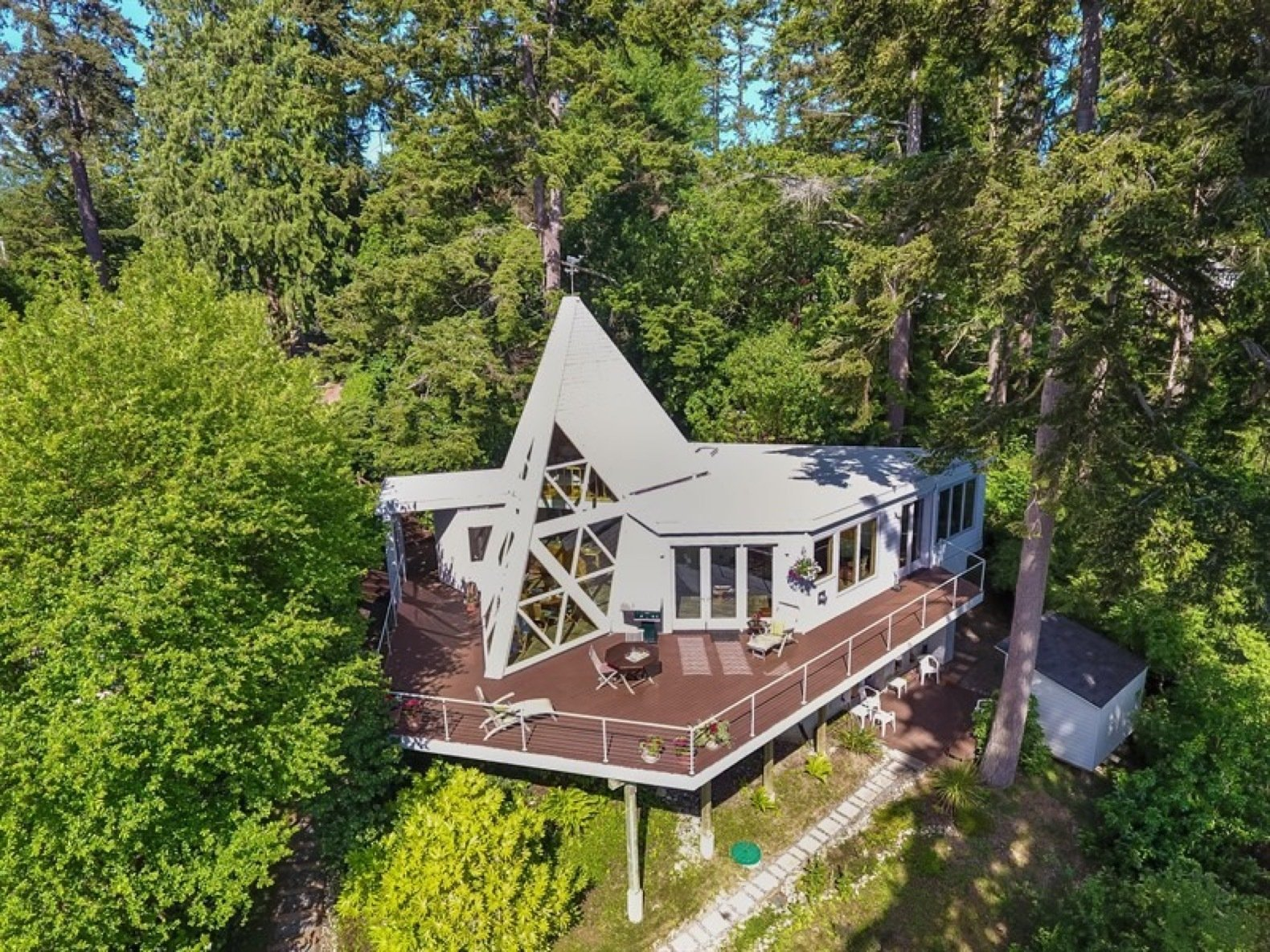Exterior, House Building Type, Flat RoofLine, Wood Siding Material, Shingles Roof Material, and Cabin Building Type A Bellevue architect designed the home's original tetrahedron shape, which has striking triangular windows that overlook the Saratoga Pass.     Photo 1 of 11 in A Tetrahedron Cabin With Stellar Seaside Views Is Listed For $695K