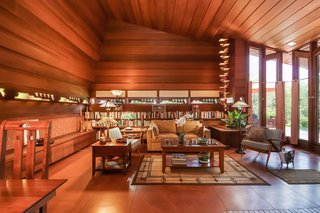 The Whiteford-Haddock House features an L-shaped design based on a two-by-four rectangular module. Pictured is the great room, which is lined with horizontal redwood panels and built-in furnishings.