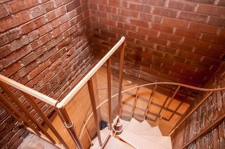 A spiral staircase leads to the basement utility room and laundry room.
