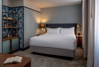 The standard King Room offers courtyard rooms and TRI-KES wallcovering.