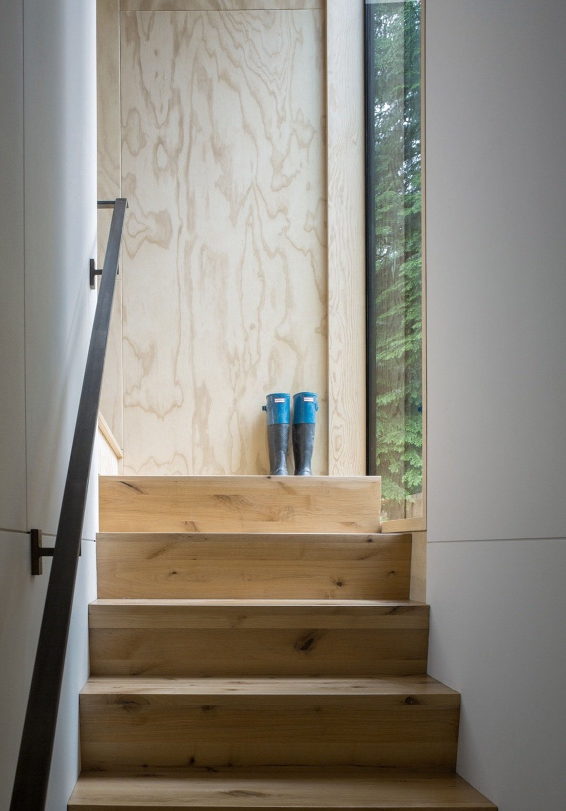 Staircase, Wood Tread, and Metal Railing Timber stairs connect the entry to the upstairs bedrooms.    Photo 7 of 15 in This Little House in Washington Has Mighty Big Ties to Nature