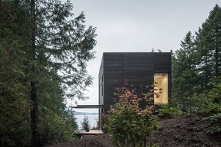 The home is approached from the south with views of Hood Canal below.