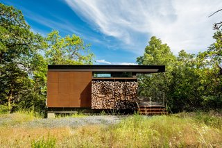 Each cabin was assembled from single, mostly completed modules craned into place and raised atop concrete piers. The cabins include a bedroom and bathroom, a study desk, a covered porch and a fire pit.