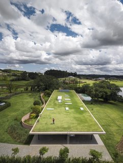 """The green roof is accessible via ladder. """"This type of insertion on the plot demanded care and attention with the design of the rooftop, which is the fifth facade of the building,"""" adds the architects."""