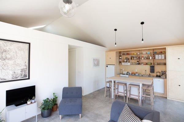 A small loft was built over the bedrooms for out-of-town guests. The space is illuminated with an operable skylight.