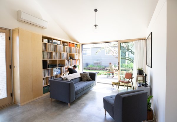 To help create the illusion of more space, the great room features a vaulted ceiling and opens up to the outdoors with 12-foot wall-to-wall glazed sliding doors.