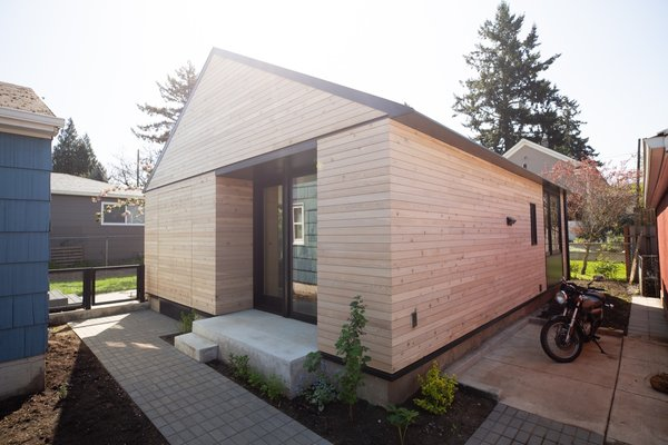 Floor-to-ceiling glazing is installed on all four sides of the house; however, the glazed openings are recessed to different degrees to follow passive solar principles.