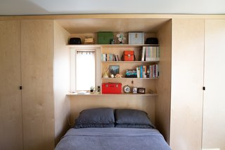 The interior shelving and cabinetry was fabricated locally by ADX from sealed birch plywood.