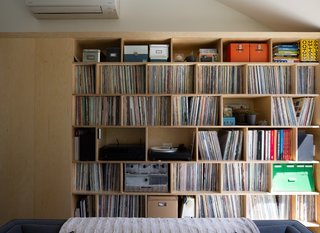 Scott's extensive record collection occupies a large portion of the living room wall.