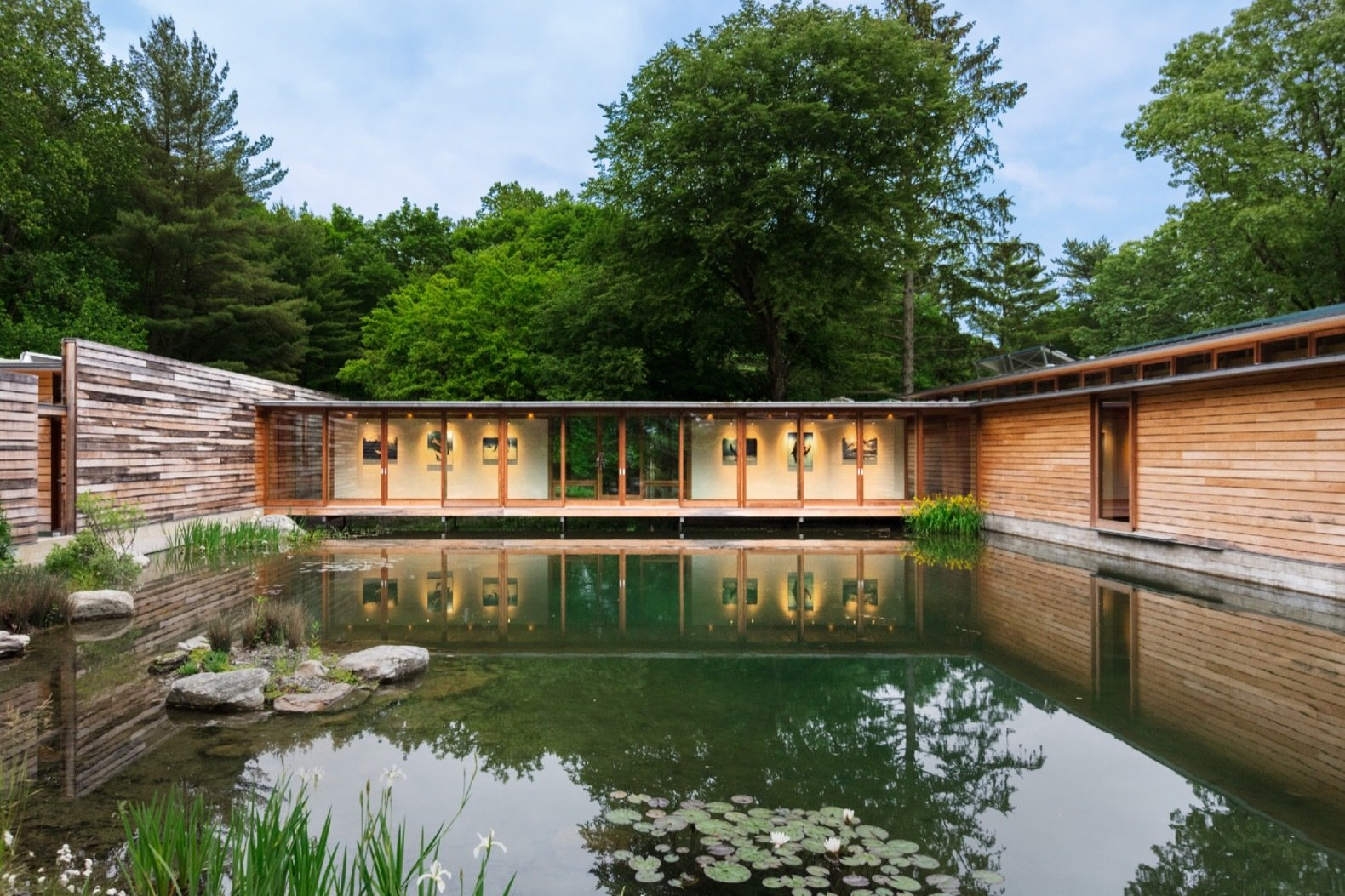 This striking net zero home wraps around a serene pond dwell for Anderson architects
