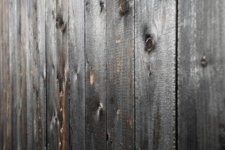The exterior larch facade was treated using Shou Sugi Ban, an ancient Japanese exterior siding technique that involves charring the surface to preserve and protect the wood.