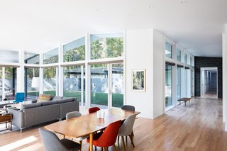 The tall white-painted ceiling and walls give the light-filled living room a bright and airy vibe.