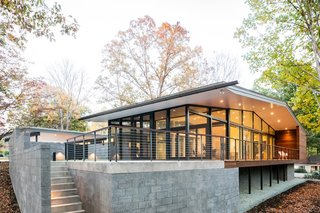 """The """"living pavilion"""" on the southern wing is elevated to make the space level with the home."""