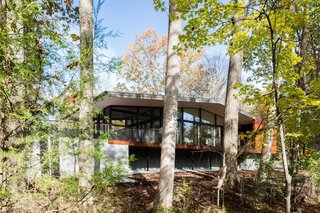 The Trull Residence is topped with a thin, broad roof that has four-foot eaves and a six-inch tapered fascia.