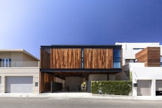Casa Ga2 stands out from its neighbors with its facade clad in vertical timber.