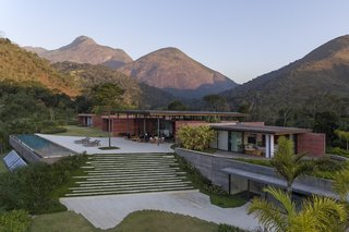 Lush greenery surrounds Casa Terra to make the building feel like an extension of the landscape.
