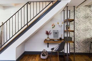 A small workspace now takes advantage of the cozy nook beneath the stairs.