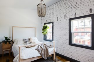 The brick wall was exposed in the master bedroom for an extra pop of texture.