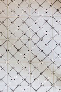 A close up of the dainty tile floors in the revamped bath.