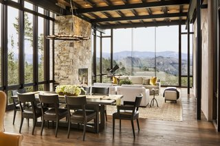 Full-height glazing ushers in incredible views of the hills to the south.