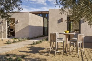 The library, kitchen, and master suite are housed within the plaster cubes.