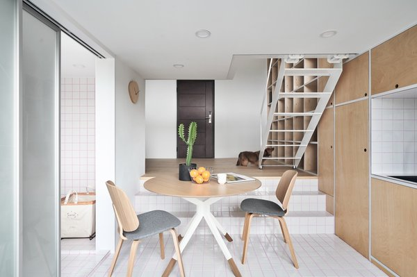 The living area and eat-in kitchen are separated by a level change.