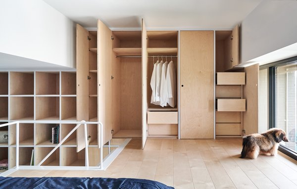 The minimalist built-in storage units draw inspiration from the Japanese brand MUJI.