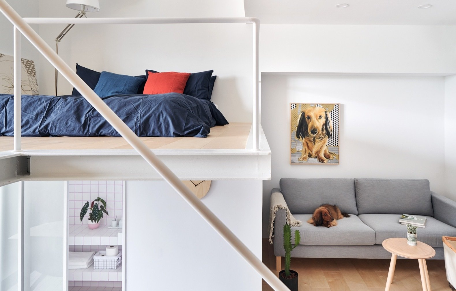 Bedroom, Bed, Floor Lighting, and Light Hardwood Floor White walls and a partial double-height ceiling help lend a sense of spaciousness to the abode.    Photo 5 of 17 in A Tiny Taipei Apartment Pursues Muji-Like Minimalism For $35K