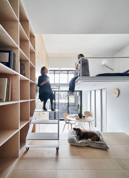 The apartment opens up to a small terrace through glazed doors.