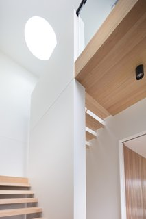 """As soon as you walk in the front door, your eye is drawn to the circular skylight above, which casts directed light to the open stairs below,"" explains Modscape."