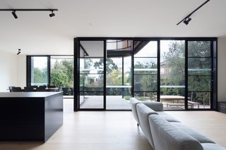 A giant wall of glass connects the living spaces with the outdoors. The double-glazed, low-e windows are thermally broken with black-powder coated frames.