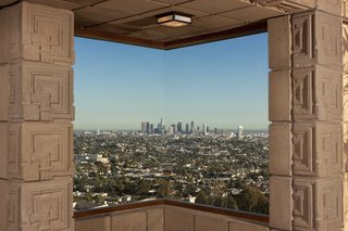 One of three corner windows in the home frames panoramic views of the Los Angeles Basin.