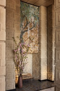 This stunning Wisteria glass-mosaic placed above the living room fireplace is one of only four of its kind ever designed by Wright, and is the only extant example.