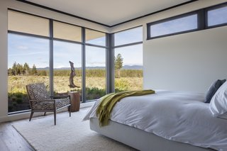 Full-height glazing wraps around the south-facing side of the master bedroom.