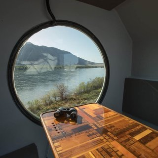 The porthole in the breakfast nook overlooks the Columbia River.