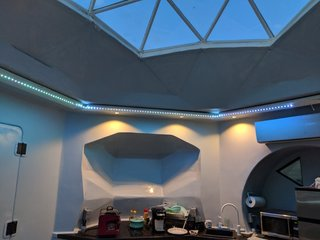 LED strip lighting and recessed ceiling lights illuminate the space at night.