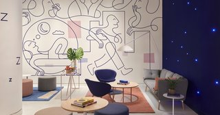 """""""Dream-inducing murals"""" decorate the walls of the softly lit lounge."""